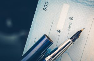 A person who writes a check with insufficient funds in their account could receive an NSF fee.