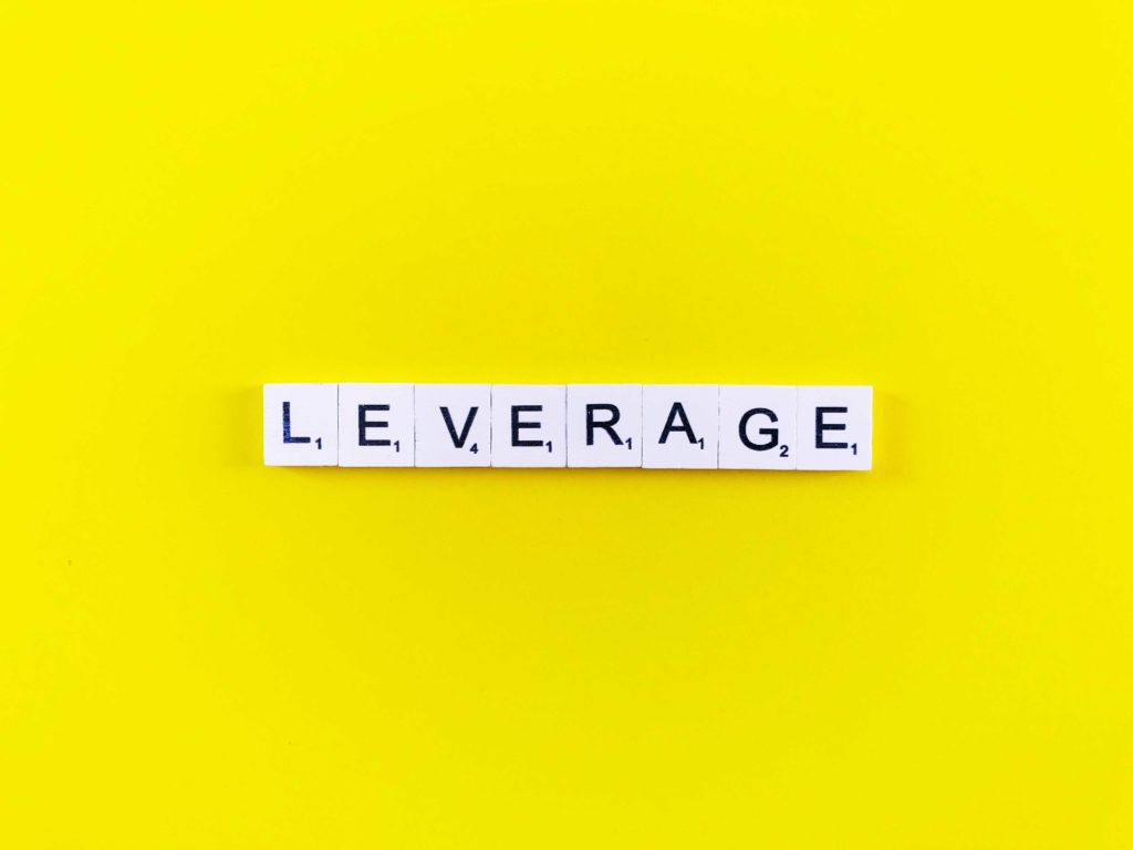 Scrabble tiles spell out the word leverage
