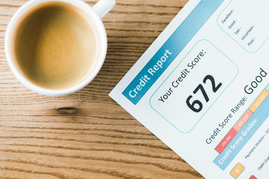 Overhead photograph of cup of coffee and credit score