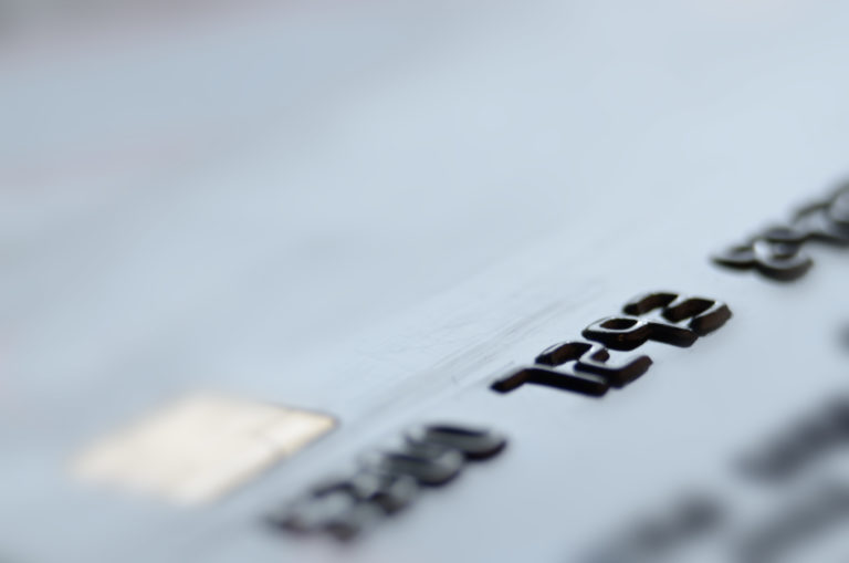Close up of debit card with raised numbers