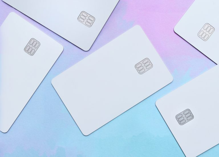 Blank credit cards laying on pastel background