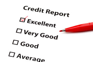 Credit report with red pen and check mark next to Excellent