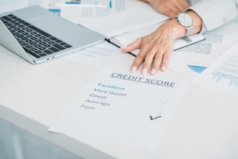 Woman shows poor credit score on desk